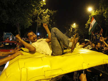A cricket fan celebrates on top of an auto-rickshaw in New Delhi. Reuters
