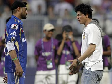 Mumbai Indians skipper Harbhajan Singh speaks to KKR owner Shah Rukh Khan. AP