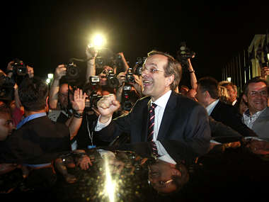 Leader of conservative New Democracy party Samaras is cheered by supporters after his statement on the election results in Athens. Reuters