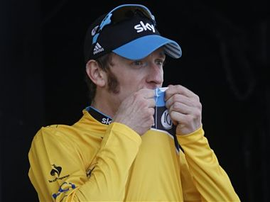 Bradley Wiggins of Britain kisses the overall leader's yellow jersey on the podium of the 19th stage of the the Tour de France cycling race. AP