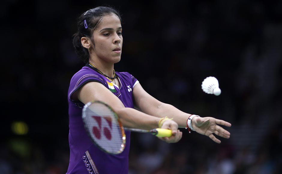 Saina Nehwal serves while playing against Netherlands' Yao Jie, unseen, at a women's singles badminton match. Saurabh Das/AP
