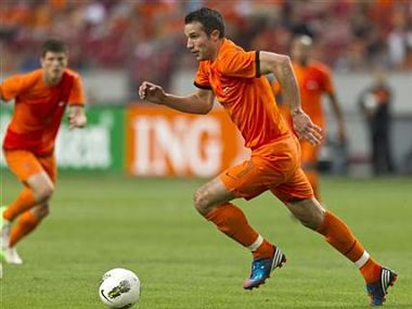 Robin van Persie of the Netherlands runs with the ball during their friendly soccer match against Bulgaria in Amsterdam. Reuters