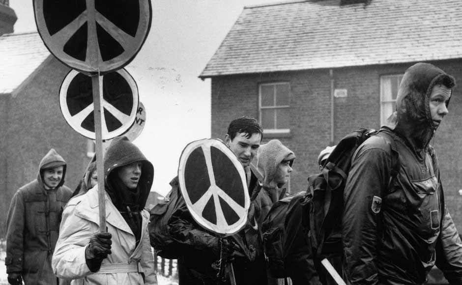 Rain soaked CND marchers carrying their anti-nuclear logos at Aldermaston on 17 April 1958. Express Newspapers/Getty Images