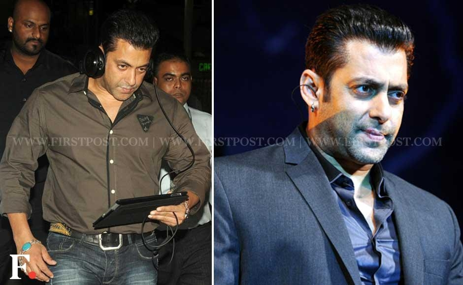 Salman Khan listening to music on his iPad at Mumbai airport on Saturday night. A day later he appeared with what looked like a love bite, at the launch of Bigg Boss 6. Sachin Gokhale/Firstpost