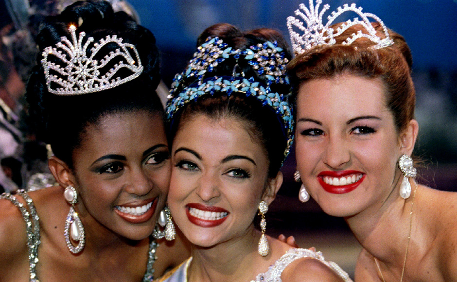 Miss South Africa Basetsane Julia Makgalemele (L), Miss India Aishwarya Rai (C) and Miss Venezuela Irene Izquierdo (R) smile for photographers moments after Rai was crowned Miss World on 19 November 1994. Reuters