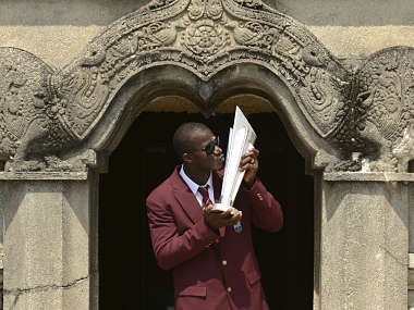 West Indies' captain Darren Sammy kisses the trophy at Independence Memorial Hall in Colombo. Reuters