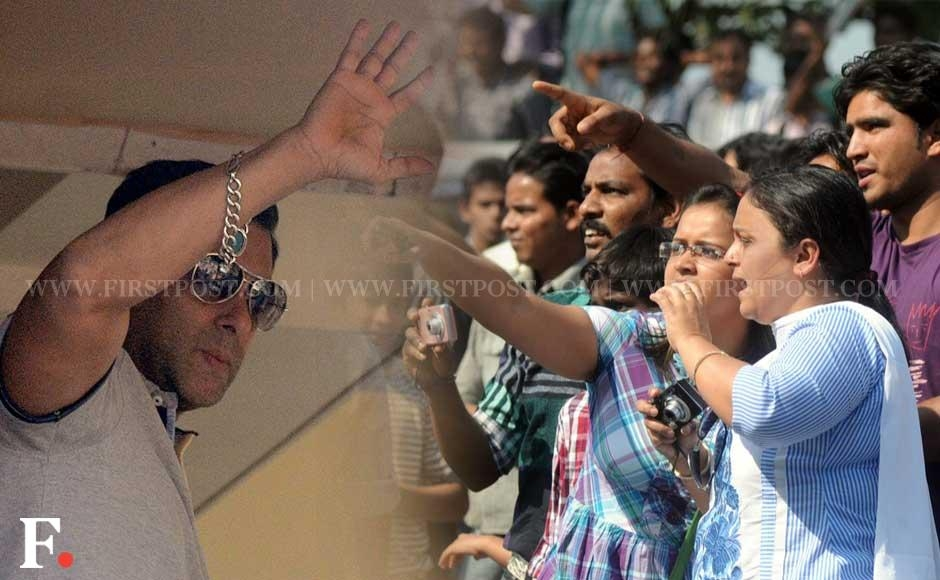 Waiting fans start screaming in joy as Salman Khan waves at them from his Galaxy Apartments home on his birthday earlier this afternoong. Sachin Gokhale/Firstpost