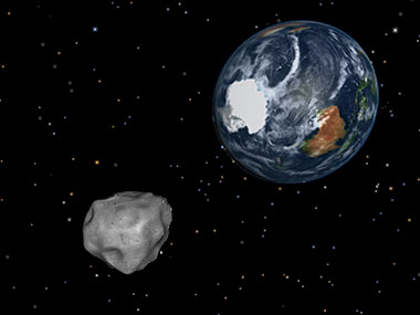 This image provided by NASA/JPL-Caltech shows a simulation of asteroid 2012 DA14 approaching from the south as it passes through the Earth-moon system. AP