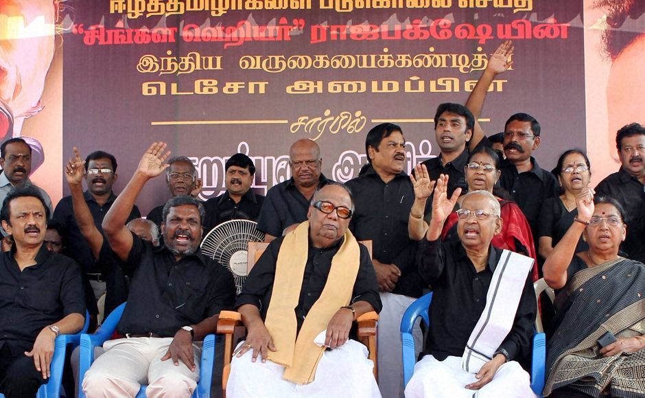 DMK chief M Karunanidhi along with members of Tamil Eelam supporters organization(TESO), put on black outfits to protest against Sri Lankan President Mahinda Rajapaksa's visit to India, at Valluvar Kottam in Chennai. PTI