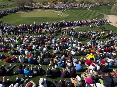 Fans watch Phil Mickelson on the second green. AP