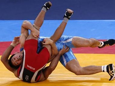Japan's Tatsuhiro Yonemitsu (in blue) fights with India's Sushil Kumar in the final of the Men's 66Kg Freestyle wrestling during the 2012 Olympic Games. Reuters