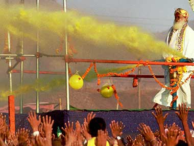 Asaram Bapu playing Holi with followers at Airoli, Thane. PTI