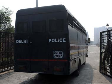File photo of Police van with Delhi gangrape accused. AFP