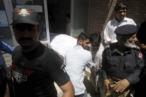Pakistani hospital staff transfer the body of jailed Indian spy Sarabjit Singh after an autopsy at a local hospital in Lahore: AFP