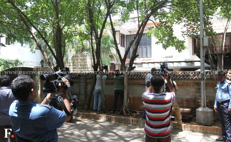 Reporters and photographers outside Meiyappan's house. Firstpost.