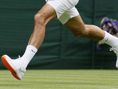 Wimbledon ruled that there was too much orange on Federer's shoes. Reuters