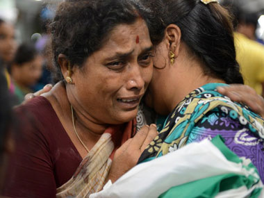 Pilgrims, who were stranded in Kedarnath weep on arrival at the railway station in Secunderabad. AFP