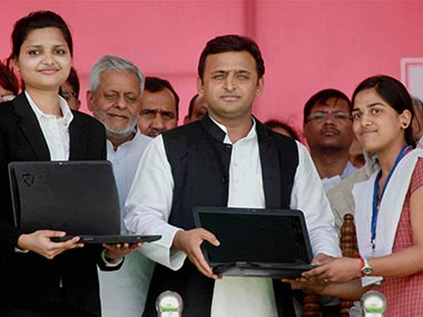 Akhilesh Yadav distributing laptops to students in this file photo. PTI