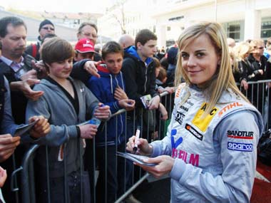 Susie Wolff signs autographs. Getty Images