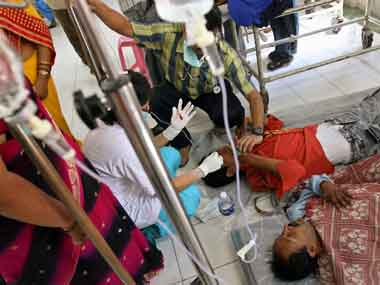 Dengue patients lie on floors due to lack of space at a hospital in a New Delhi. PTI