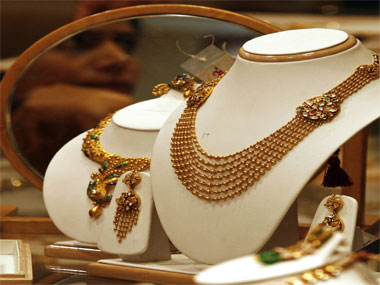 Premiums rose four fold to $20 an ounce on London prices on Thursday after the Reserve Bank of India tightened gold imports, making them dependent on export volumes with an eye to reducing a record current account deficit.