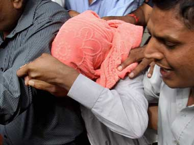 The juvenile accused in the 16 December  gangrape and murder of paramedical student, is escorted after he was produced before the Juvenile Justice Board in New Delhi on Saturday. PTI
