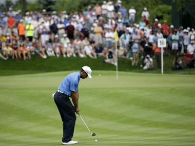 Tiger Woods plays a chip shot on the 16th hole. AP