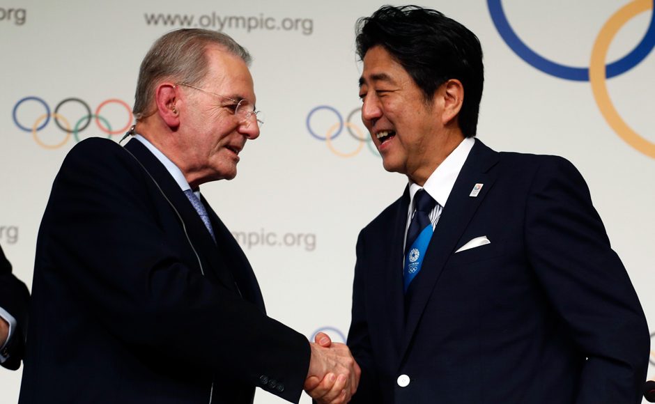 Prime Minister Shinzo Abe (R) of Japan shakes hands with Jacques Rogge, president of the International Olympic Committee (IOC), during the Signature of the Host City Contract ceremony after Tokyo was selected as the city to host the 2020 Summer Olympic Games in Buenos Aires September 7, 2013. REUTERS/Enrique Marcarian