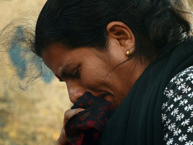A protester breaks down during a rally in Delhi. AFP