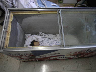 The body of two-and-a-half-year-old Palestinian girl Raghad Massoud, killed in an Israeli air strike, is seen inside an ice-cream freezer. Reuters image