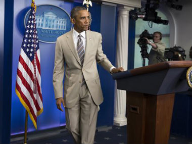 Obama's beige suit didn't get him too points with the fashion police. AP
