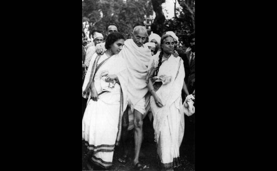 <p> In this photo, Mahatma Gandhi is seen leaving Maor Ville, his Simla residence, during the Leaders Conference. He is helped to his car by his doctor Sushelia Nayyer, right, and Susila Ben, left, and accompanied by his private secretary Mr Piare Lal. Getty Images</p>