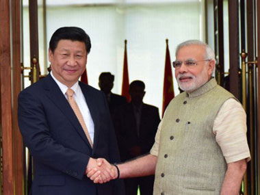 PM Narendra Modi with Chinese President Xi Jinping. Agencies