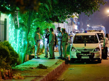 Police officials on spot where a low intensity bomb blast occurred at church street in Bengaluru on Sunday night. PTI