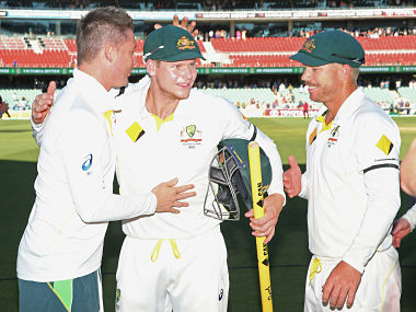 Michael Clarke congratulates Steven Smith and David Warner after winning the first Test against India. Getty