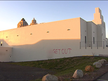 'Get out' painted on the temple wall.Agencies