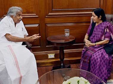 Kerala CM Oommen Chandy with Foreign Minister Sushma Swaraj. PTI
