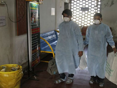 electricians wearing protective suit prepare to enter an isolation ward for swine flu at the Civil Hospital in Ahmedabad, India. Representational Image. AP