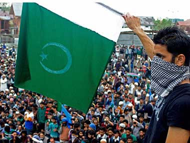 A Geelani supporter waves a Pakistan flag at the rally: PTI