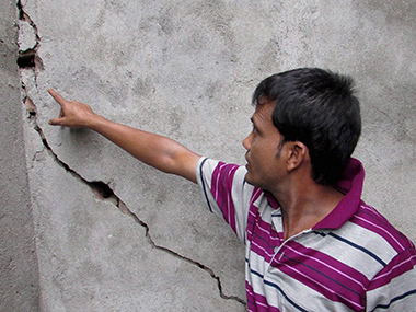 A man shows the cracked wall of his house due to the earthquake at Civil Lines at Dhupguri in Jalpaiguri, West Bengal. PTI