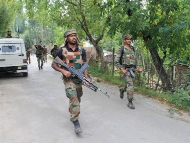 Army officials during a search operation in Kashmir. PTI image