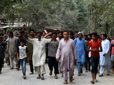 Protesters in the funeral procession of a youth allegedly killed in BSF firing. AFP.