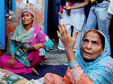 Relatives mourn the death of farmer Mohammad Akhlaq at his home in Bisara village. PTI