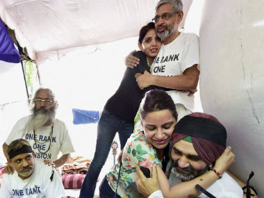 Military veterans who are on hunger strike, being greeted by their family members after the announcement of the implementation of OROP scheme by the government, at Jantar Mantar in New Delhi on Saturday. PTI