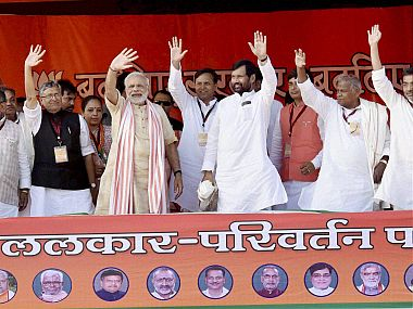 Prime Minister Narendra Modi waves along with HAM(S) chief Jitan Ram Manjhi, LJP chief Ram Vilas Paswan, RLSP supremo Upendra Kushwaha and other NDA leaders . PTI Photo