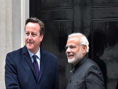 Prime Minister Narendra Modi and his UK counterpart David Cameron shake hands before a delegation level meeting at 10 Downing Street in London on Thursday. PTI