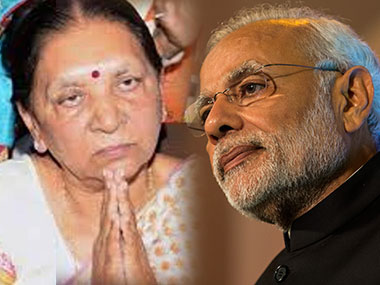Anandiben and Narendra Modi in file photos. Getty Images/ Ibnlive
