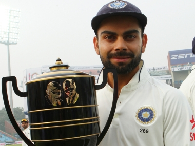 Indian Test captain Virat Kohli with the Freedom trophy after series win at Kotla. BCCI
