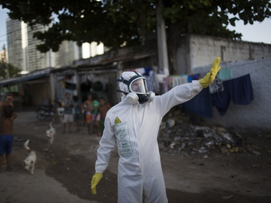 A municipal worker gestures during an operation to combat the Zika virus in Brazil. AP