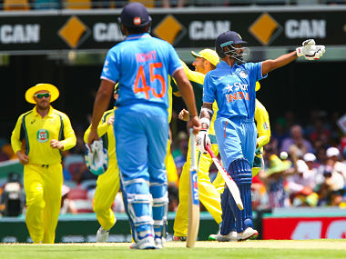Shikhar Dhawan (R) reacts after being dismissed by Australia's Joel Paris in 2nd ODI. AFP